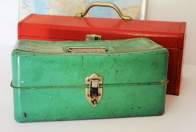 Green and red vintage tool boxes