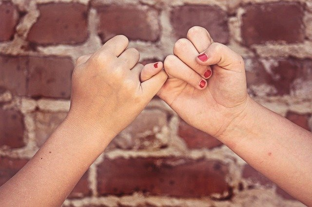 Two People Making Pinky Promise