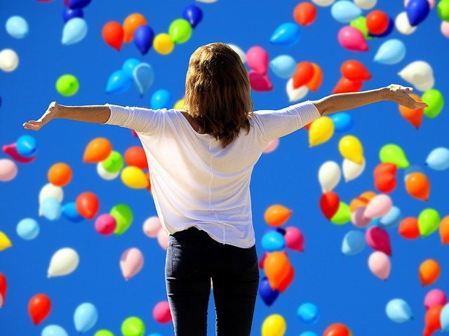 Positive Woman With Balloons