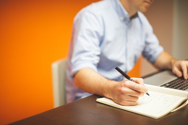 Mindfulness For Entrepreneurs Man Writing At Desk