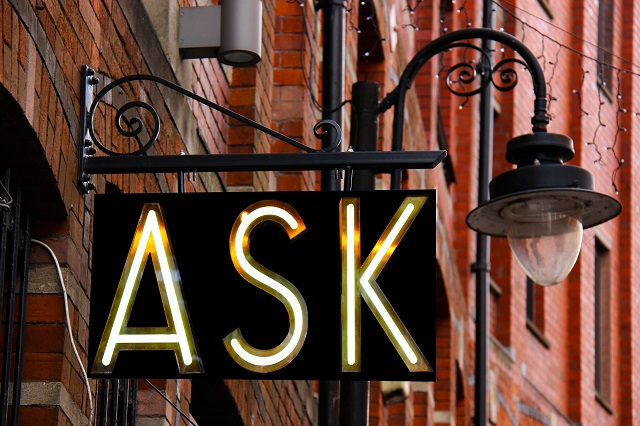 Street Sign And Lamp With The Word Ask In Lights