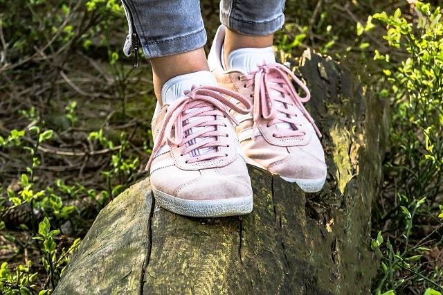 Girl Taking Steps Through Forest