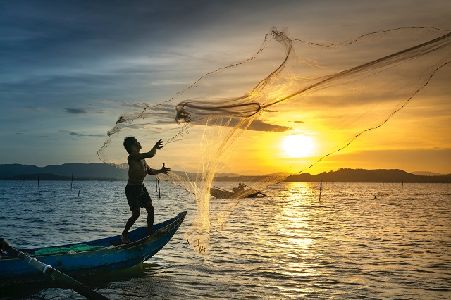 Man Throwing Fishing Net
