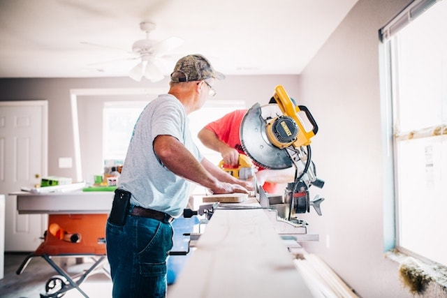 Real Estate Business Ideas Man Renovating Property