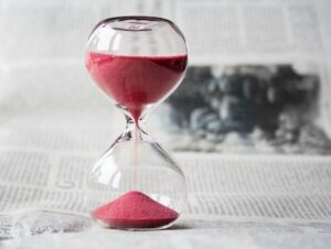 Red Hourglass Illustrates Time Commitment for Domaining