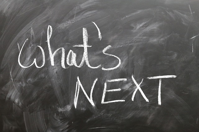 Reinvent Yourself Whats Next Written on Blackboard