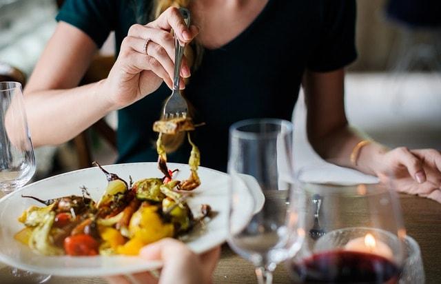 SEO For Restaurants Woman Sampling Dish