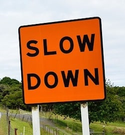 Slow Down Sign Represents Taking Time When Investing in Domains