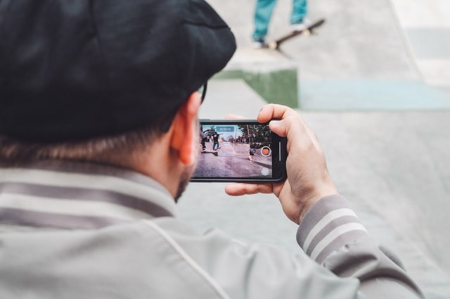 Social Media Tips Man Filming With Smartphone