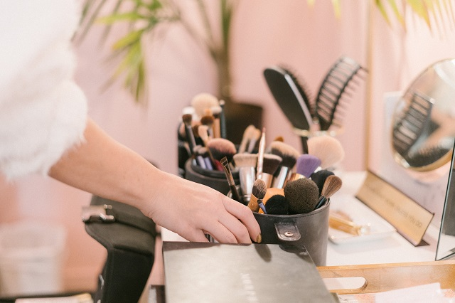 Makeup Brushes And Accessories On A Desk