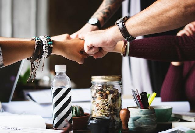 Starting a Web Design Agency Team Fist Bump