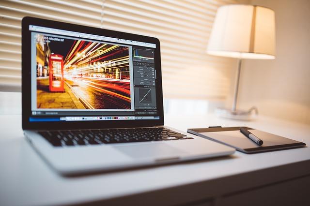 Starting a Web Design Agency Website Code on Laptop