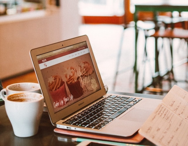 Starting a Web Design Business Laptop in Coffee Shop