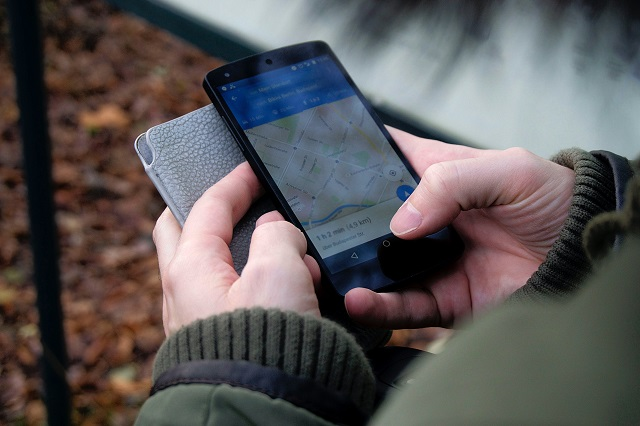 User Checking Map On Smartphone