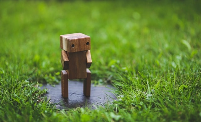 Wooden Robot Standing In Grass