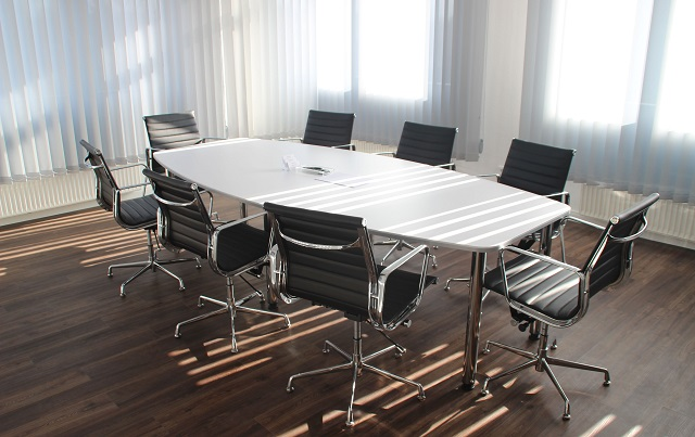 Empty Conference Room Table Surrounded By Chairs