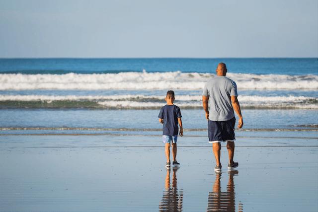 Tyson Toussant and Son Walking on Beach