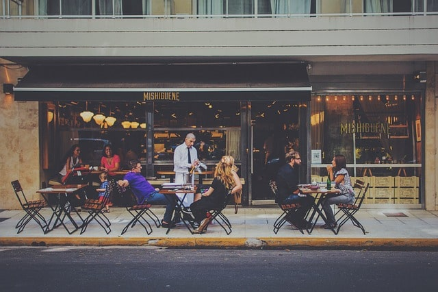 Using Twitter For Restaurants Waiter Serving Customers