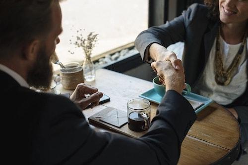 Web Design Contract Handshake Over Coffee