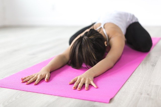 Woman Doing Yoga Illustrates Wellness Blog