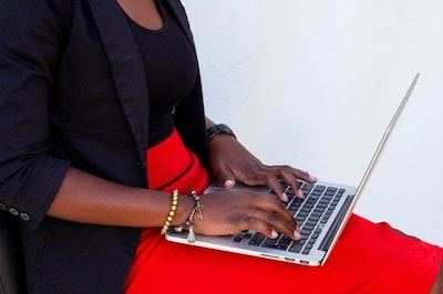 Woman Typing on Laptop Represents Domain Security Practices
